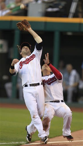 Cleveland Indians' Jason Kipnis, left, catches a ball hit by Tampa Bay Rays' Luke Scott in the fifth inning in a baseball game Friday, July 6, 2012, in Cleveland. Shin-Soo Choo, of South Korea, backs up Kipnis. Scott was out. (AP Photo/Tony Dejak)