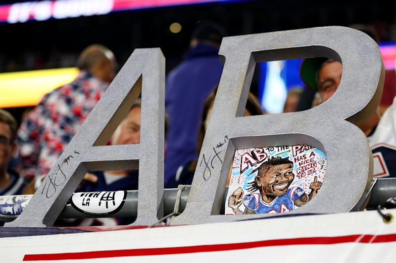 He didn't play on Sunday night, but fans at Gillette Stadium were ready to welcome Antonio Brown. (Getty Images)