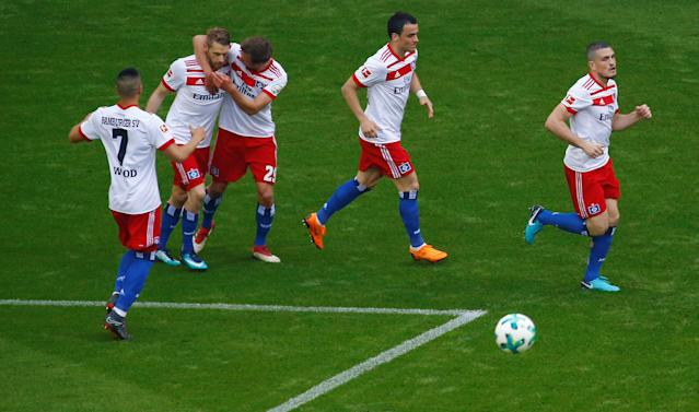 Soccer Football - Bundesliga - Hamburger SV v Borussia Moenchengladbach - Volksparkstadion, Hamburg, Germany - May 12, 2018 Hamburg's Aaron Hunt celebrates scoring their first goal with Matti Steinmann and and team mates REUTERS/Morris Mac Matzen DFL RULES TO LIMIT THE ONLINE USAGE DURING MATCH TIME TO 15 PICTURES PER GAME. IMAGE SEQUENCES TO SIMULATE VIDEO IS NOT ALLOWED AT ANY TIME. FOR FURTHER QUERIES PLEASE CONTACT DFL DIRECTLY AT + 49 69 650050
