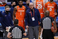 Syracuse coach Jim Boeheim, center, talks with the officials during a break in the action as the team played San Diego State during the first half of a college basketball game in the first round of the NCAA men's tournament at Hinkle Fieldhouse in Indianapolis, Friday, March 19, 2021. Syracuse won 78-62. (AP Photo/AJ Mast)