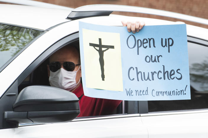Demonstrators in Annapolis, Md., demand restrictions on church gatherings be lifted in April. (Tom Williams/CQ Roll Call via Getty Images)
