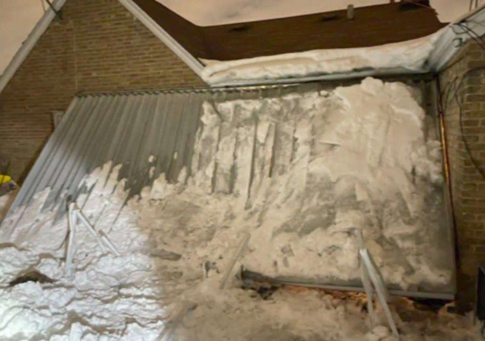Woman trapped for hours beneath collapsed snow-laden canopy