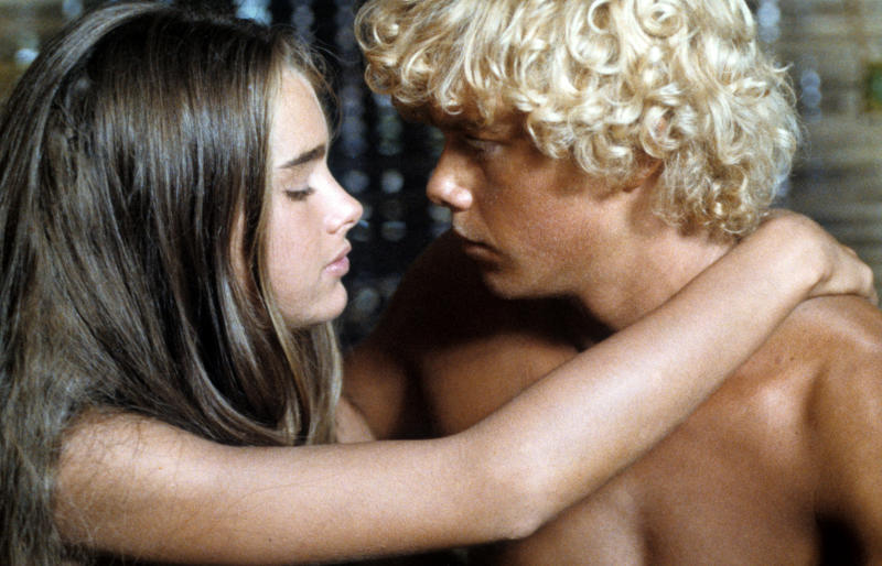 Brooke Shields with her arms around Christopher Atkins shoulders in a scene from the film 'Blue Lagoon', 1980. (Photo by Columbia Pictures/Getty Images)