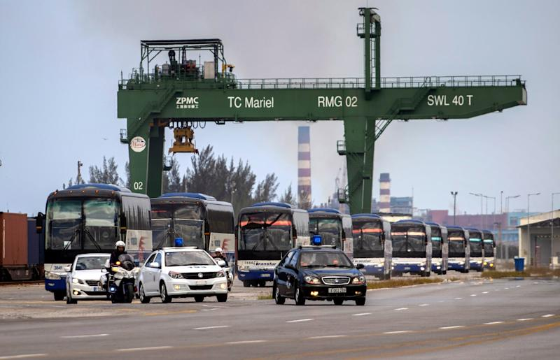 Buses escorted by the police transport the passengers of the British cruise ship MS Braemar to the Jose Marti International Airport, from Puerto del Mariel, Cuba, where the vessel was allowed to dock: EPA