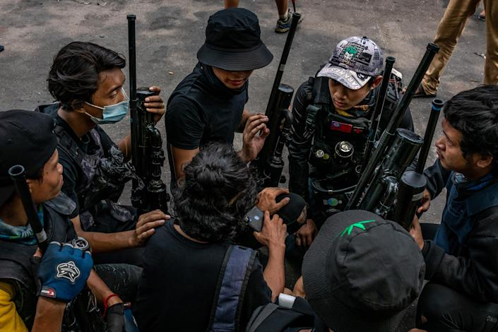 Anti-coup protesters hold improvised weapons during a protest in Yangon, Myanmar, on April 3, 2021.