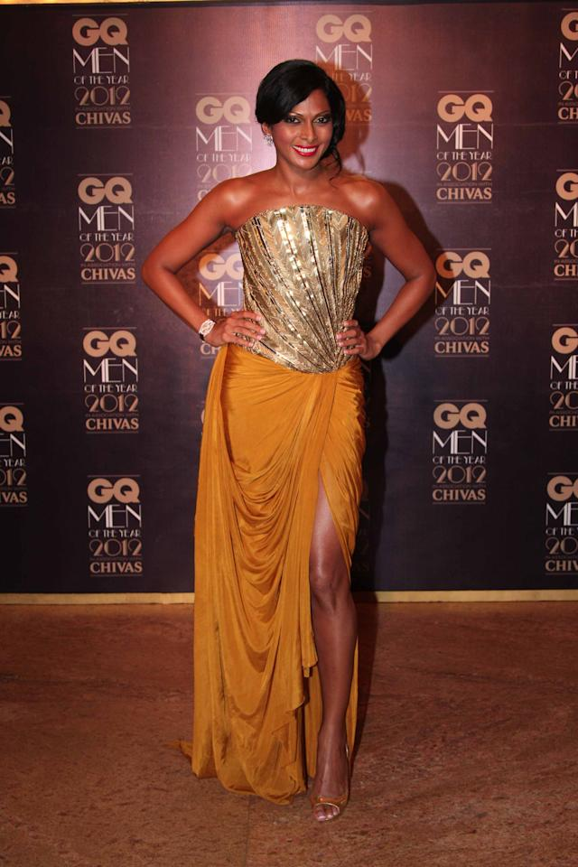 Standing out in gold corseted and mustard gown is model and tv show host Nina Mannuel.