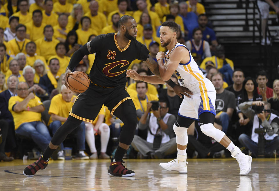 Jun 12, 2017; Oakland, CA, USA; Cleveland Cavaliers forward LeBron James (23) is defended by Golden State Warriors guard Stephen Curry (30) during the third quarter in game five of the 2017 NBA Finals at Oracle Arena. Mandatory Credit: Kyle Terada-USA TODAY Sports