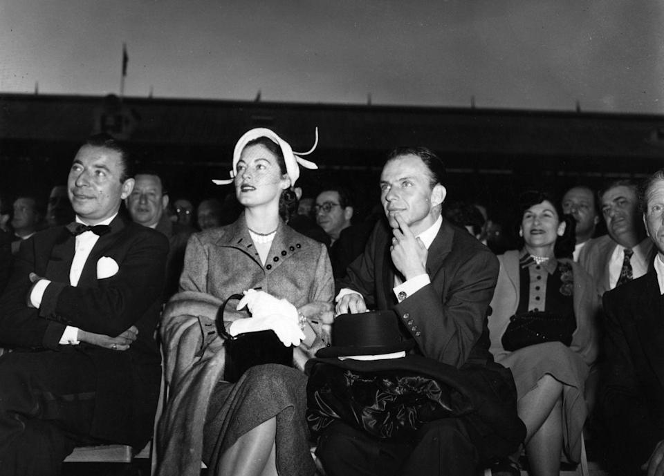 <p>Gardner wears a prim suit set and feathered Juliette-style hat to the front row at White City Stadium to watch a boxing match between Randolph Turpin and Charles Homez with then-husband Sinatra. <br></p>
