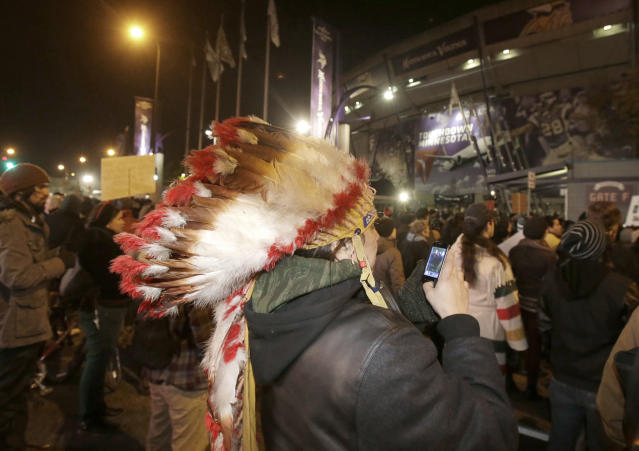 American Indians and their supporters gather outside the Metrodome during a protest against the Washington Redskins' name, before an NFL football game between the Redskins and the Minnesota Vikings, Thursday, Nov. 7, 2013, in Minneapolis. (AP Photo/Jim Mone)