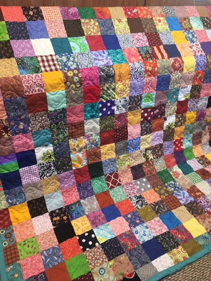 Colorful vintage quilt available on Etsy