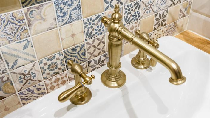brass fixcture in bathroom sink