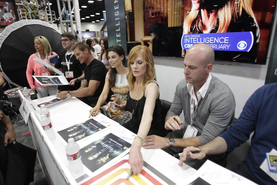 """Josh Holloway, Meghan Ory, Marg Helgenberger, and producers Michael Seitzman and Tripp Vinson at the """"Intelligence"""" booth signing during Comic-Con International 2013 at San Diego Convention Center on July 18, 2013 in San Diego, California."""