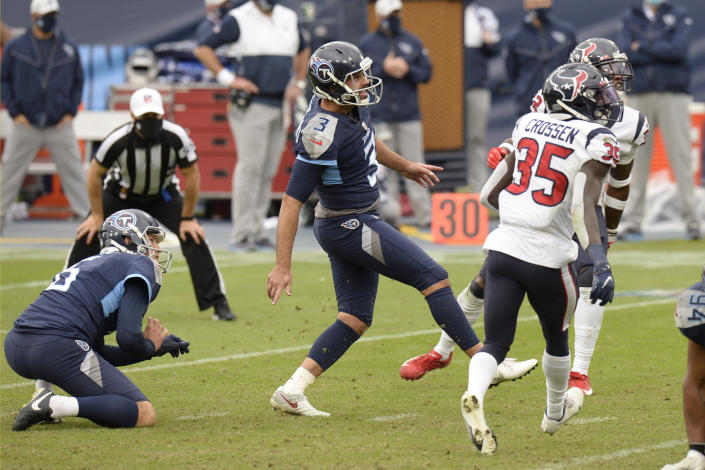 Tennessee Titans kicker Stephen Gostkowski (3) watches his kick for an extra point to tie the game against the Houston Texans in the final seconds of the fourth quarter during an NFL football game Sunday, Oct. 18, 2020, in Nashville, Tenn. The Titans won in overtime 42-36. (AP Photo/Mark Zaleski)