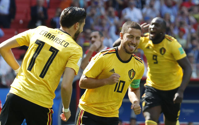 Belgium's Eden Hazard, center, celebrates after scoring their side's first goal during the group G match between Belgium and Tunisia at the 2018 soccer World Cup in the Spartak Stadium in Moscow, Russia, Saturday, June 23, 2018. (AP Photo/Hassan Ammar)