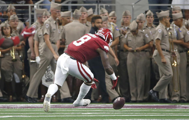 Arkansas linebacker De'Jon Harris (8) picks up a Texas A&M fumble before taking the ball into the end zone for a touchdown during the first half of an NCAA college football game Saturday, Sept. 28, 2019, in Arlington, Texas. (AP Photo/Ron Jenkins)