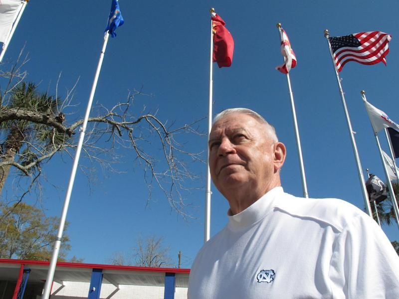 Len Loving, chief executive of the Allied Veterans Center, stands beneath the flagpoles outside the shelter for homeless veterans in Jacksonville, Fla., on Thursday, March 14, 2013. Loving says he may have to close the center by the end of June for lack of funding. The shelter gets almost all of its money from Allied Veterans of the World, a Florida organization that's had its top officers arrested and assets seized as part of an illegal gambling investigation. (AP Photo/Russ Bynum)
