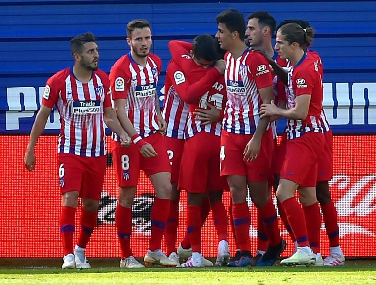 Atletico Madrid's players celebrate Thomas Lemar's winner against Eibar on Saturday