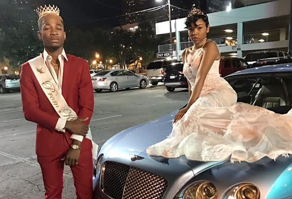 Prom attendees pose on cars in trend for 2017