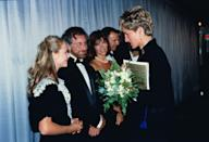 <p>At the London premiere of <em>Jurassic Park, </em>actress Ariana Richards wore a short sleeve black dress with a white lace bib. Director Steven Spielberg stands next to her, waiting for his turn to meet the Princess.</p>