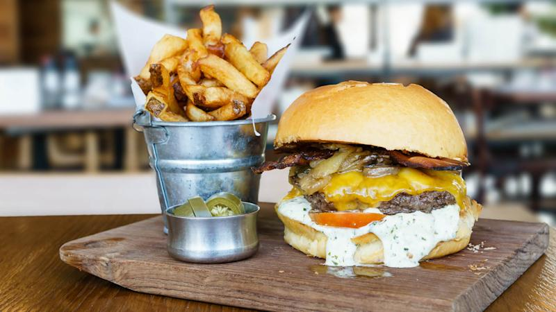 delicious cheeseburger with fries and jalapenos