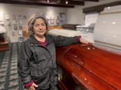 "Magda Maldonado, owner of Continental Funeral Home in Los Angeles, poses in her mortuary on Dec. 30, 2020. Southern California funeral homes are turning away bereaved families because they're running out of space for all the bodies piling up during an unrelenting coronavirus surge that has sent COVID-19 death rates to new highs. ""I've been in the funeral industry for 40 years and never in my life did I think that this could happen, that I'd have to tell a family 'no, we can't take your family member,'"" said Maldonado. (Magda Maldonado via AP"