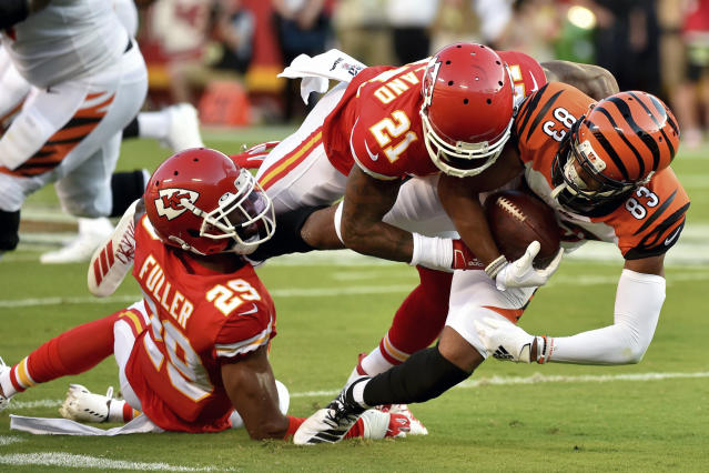 Cincinnati Bengals wide receiver Tyler Boyd (83) is tackled by Kansas City Chiefs cornerback Bashaud Breeland (21) and cornerback Kendall Fuller (29) during the first half of an NFL preseason football game in Kansas City, Mo., Saturday, Aug. 10, 2019. (AP Photo/Ed Zurga)