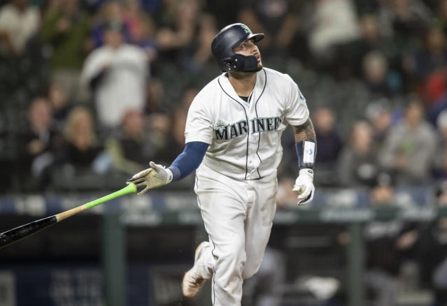 FILE - In this Sept. 14, 2019, file photo, Seattle Mariners' Omar Narvaez tosses his bat after hitting a solo home run off Chicago White Sox relief pitcher Alex Colome during the 10th inning of a baseball game, in Seattle. The Milwaukee Brewers acquired catcher Omar Narvez from the Seattle Mariners on Thursday, Dec. 5, 2019, for minor league pitcher Adam Hill and a compensation round pick in next June's amateur draft. (AP Photo/Stephen Brashear, File)