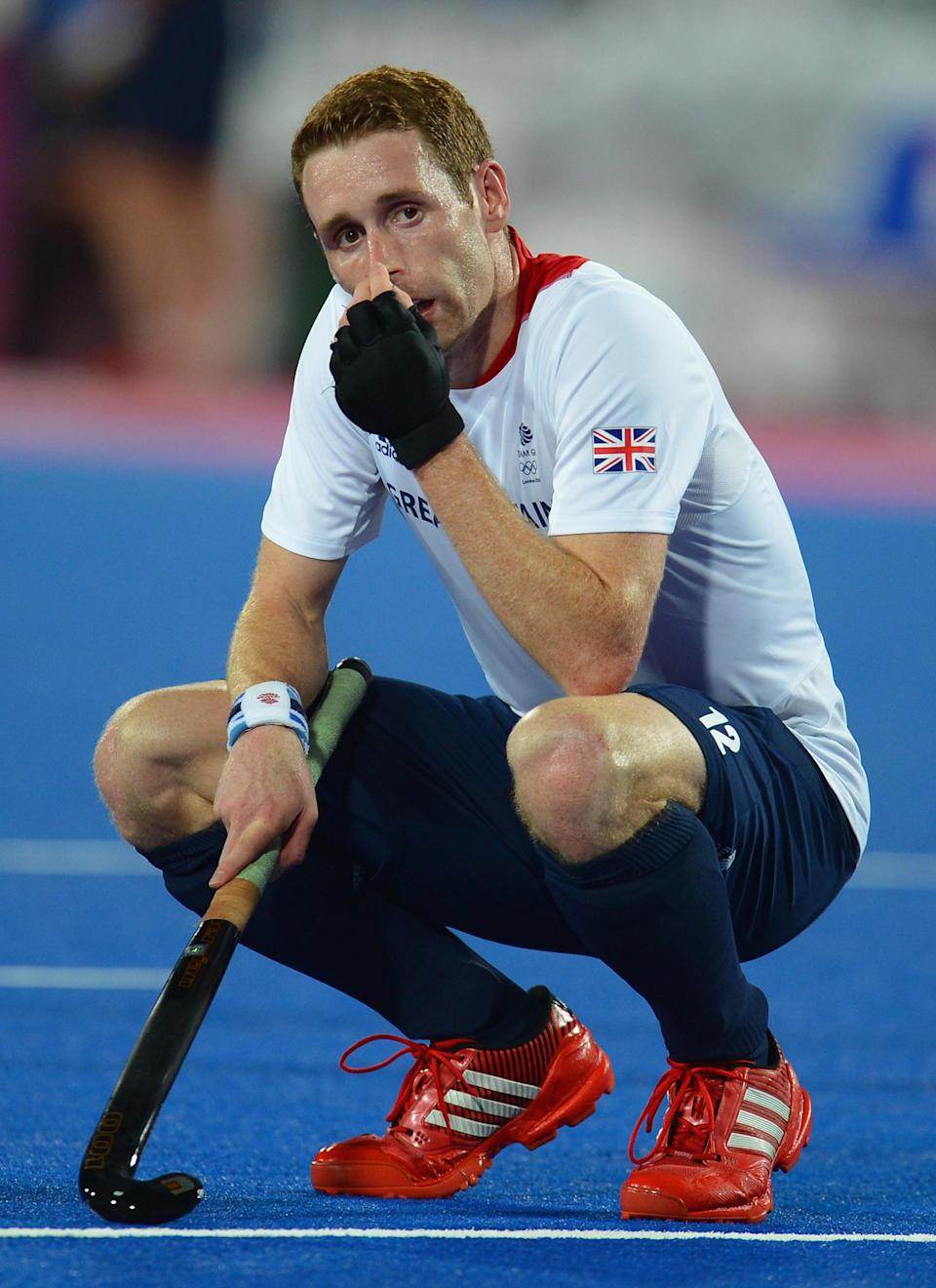 LONDON, ENGLAND - AUGUST 09: Jonathan Clarke of Great Britain looks dejected at the end of the Men's Hockey Semi Final match between Netherlands and Great Britain on Day 13 of the London 2012 Olympic Games at Riverbank Arena Hockey Centre on August 9, 2012 in London, England. (Photo by Lars Baron/Getty Images)