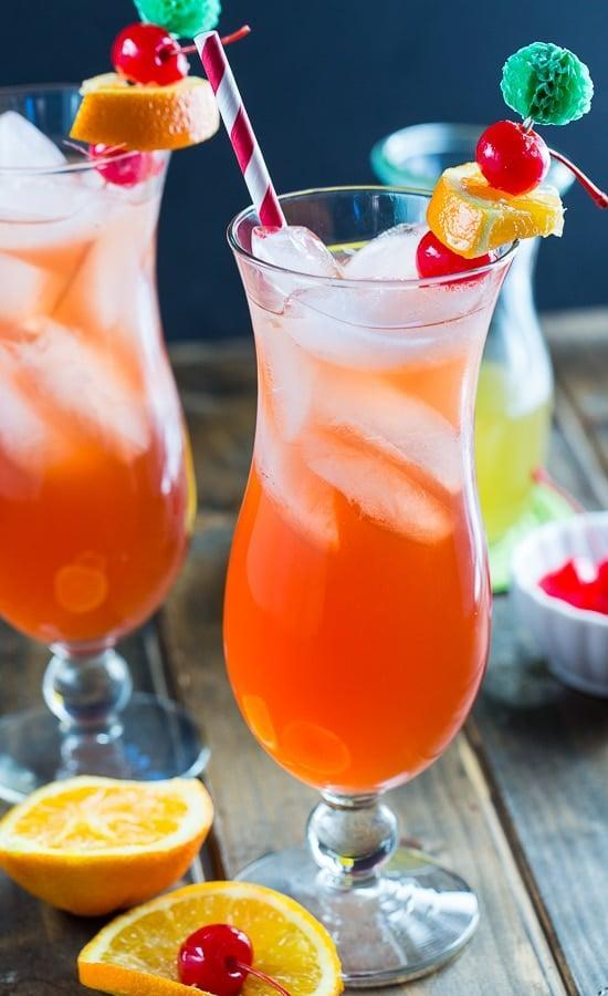 """<p>Sugar, rum, grenadine, and lime juice marry together to make this delightful drink. Put a tropical spin on it when you add a dash of passion fruit juice and garnished berries.</p> <p><strong>Get the recipe</strong>: <a href=""""https://www.popsugar.com/buy?url=https%3A%2F%2Fspicysouthernkitchen.com%2Fpassion-fruit-hurricane%2F&p_name=passion%20fruit%20hurricane&retailer=spicysouthernkitchen.com&evar1=yum%3Aus&evar9=47471653&evar98=https%3A%2F%2Fwww.popsugar.com%2Ffood%2Fphoto-gallery%2F47471653%2Fimage%2F47473187%2FColorado-Hurricane&list1=cocktails%2Cdrinks%2Calcohol%2Crecipes&prop13=api&pdata=1"""" class=""""link rapid-noclick-resp"""" rel=""""nofollow noopener"""" target=""""_blank"""" data-ylk=""""slk:passion fruit hurricane"""">passion fruit hurricane</a></p>"""