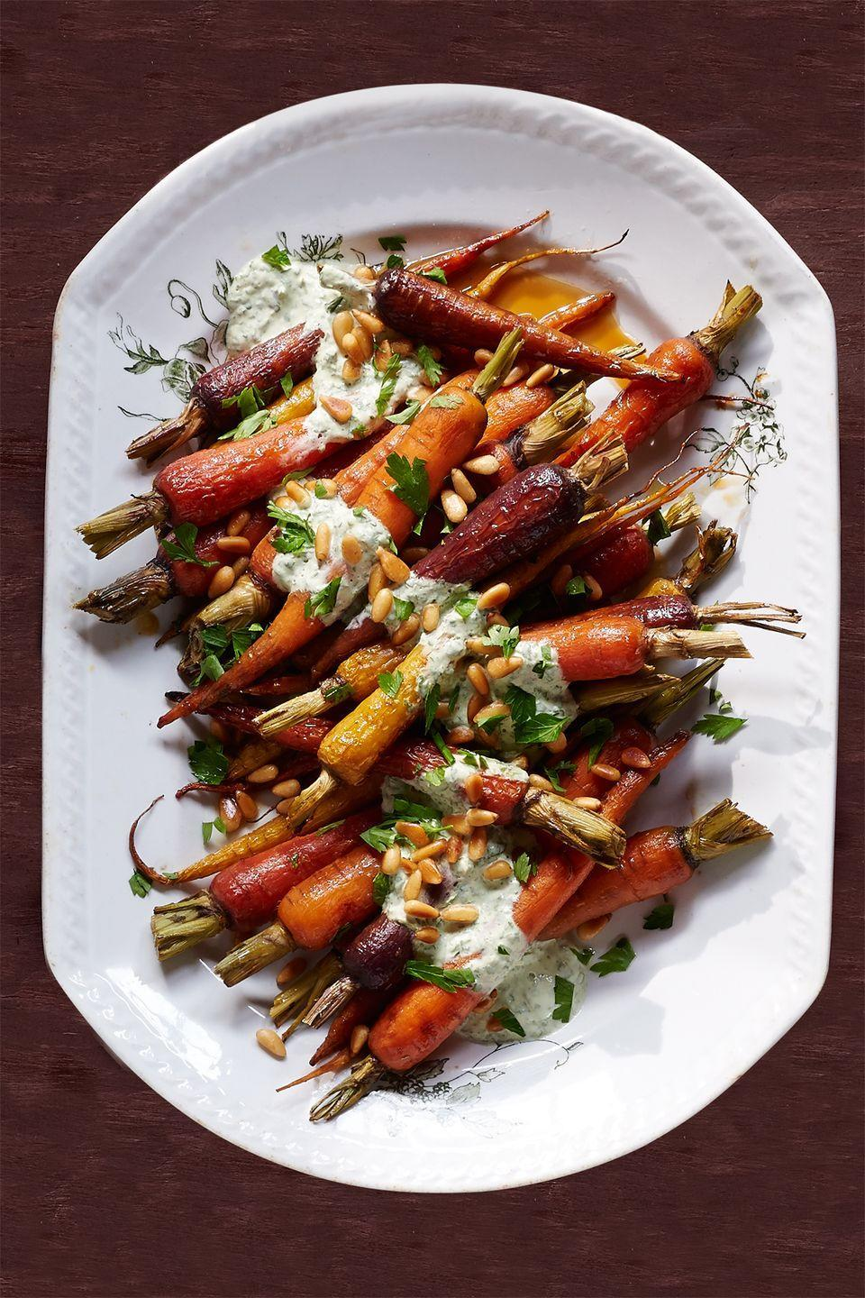 "<p>Brighten up your Thanksgiving table with these light and tangy carrots.</p><p><strong><a href=""https://www.countryliving.com/food-drinks/recipes/a36647/orange-carrots-yogurt-parsley-dressing/"" rel=""nofollow noopener"" target=""_blank"" data-ylk=""slk:Get the recipe"" class=""link rapid-noclick-resp"">Get the recipe</a>.</strong></p>"