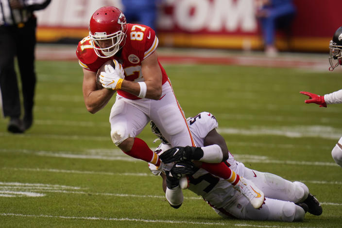 Kansas City Chiefs tight end Travis Kelce is tackled by Atlanta Falcons Foyesade Oluokun during the first half of an NFL football game, Sunday, Dec. 27, 2020, in Kansas City. (AP Photo/Jeff Roberson)