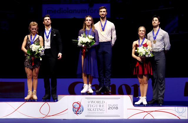 REFILE - CORRECTING IDS Figure Skating - World Figure Skating Championships - The Mediolanum Forum, Milan, Italy - March 24, 2018 - France's Gabriella Papadakis and Guillaume Cizeron pose after winning the gold medal in the Ice Dance with second placed Madison Hubbell and Zachary Donohue of the U.S. and third placed Canada's Kaitlyn Weaver and Andrew Poje. REUTERS/Alessandro Garofalo