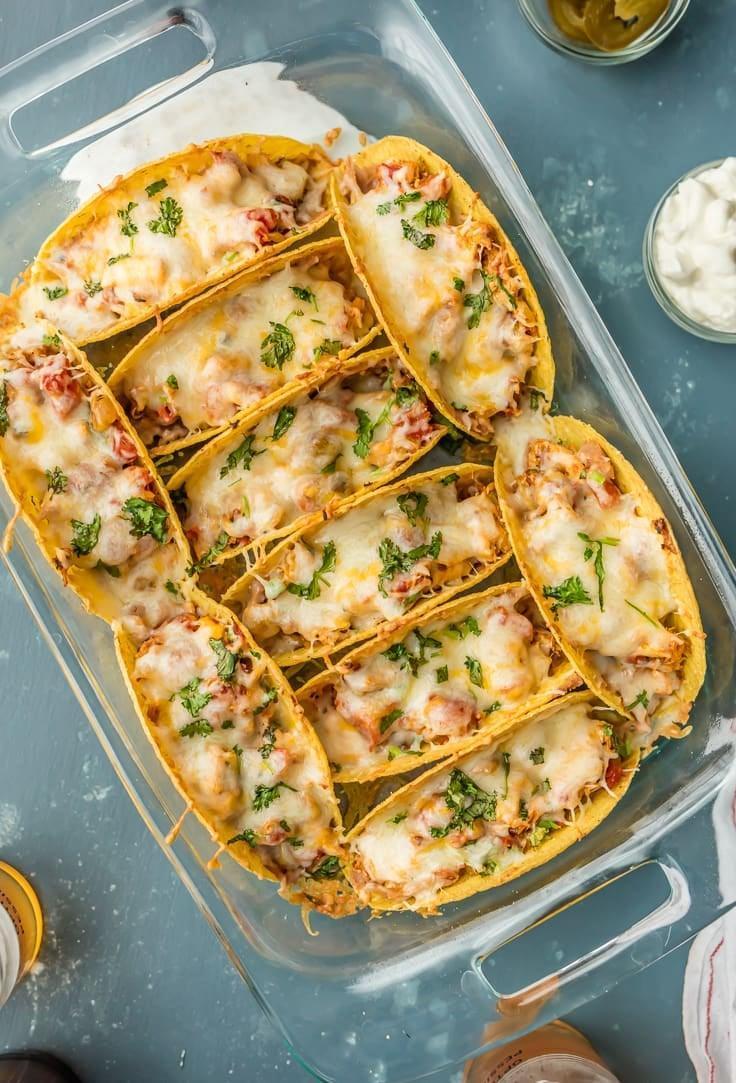 """<p>Take tacos to the next level when you whip up these baked bad boys. Easy, simple, and totally foolproof, this recipe can be made in no time at all. If you're looking to heartily feed two people, we suggest making about four or five tacos so you can both indulge.</p> <p><strong>Get the recipe:</strong> <a href=""""https://www.thecookierookie.com/baked-spicy-chicken-tacos/"""" class=""""link rapid-noclick-resp"""" rel=""""nofollow noopener"""" target=""""_blank"""" data-ylk=""""slk:baked chicken tacos"""">baked chicken tacos</a></p>"""