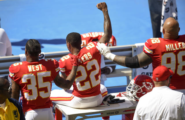 <p>Kansas City Chiefs defensive back Marcus Peters (22) protests next to running back Charcandrick West (35) and defensive tackle Roy Miller (98) during the National Anthem prior to the game against the Los Angeles Chargers at StubHub Center. (Photo: Kelvin Kuo-USA TODAY Sports) </p>