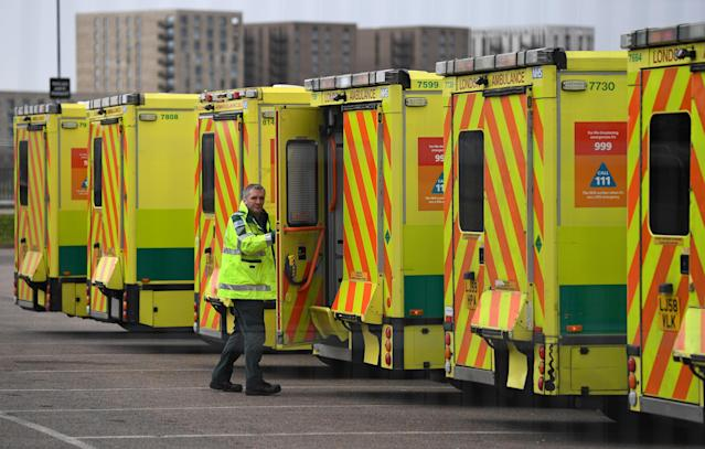 A fleet of ambulances outside the makeshift NHS Nightingale Hospital at London's ExCeL (AFP via Getty Images)
