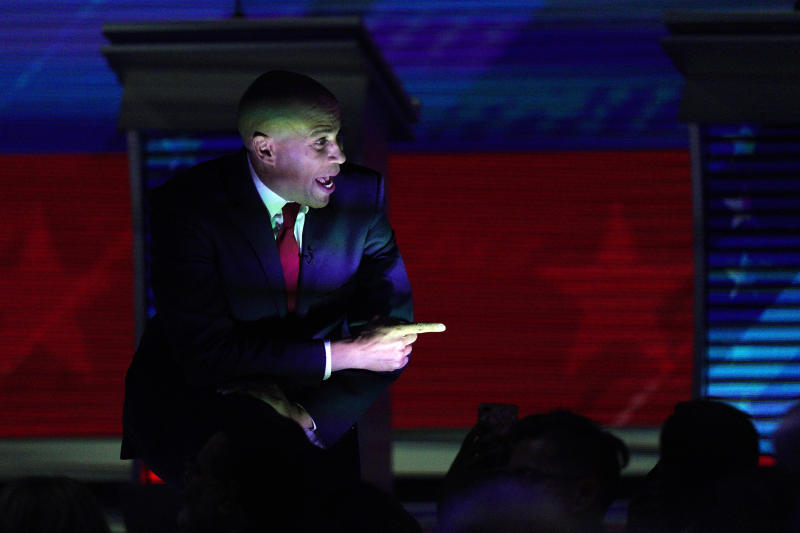 Democratic presidential candidate Sen. Cory Booker, D-N.J., greets supporters Thursday, Sept. 12, 2019, during a Democratic presidential primary debate hosted by ABC at Texas Southern University in Houston. (AP Photo/David J. Phillip)