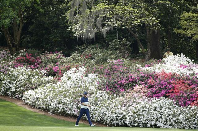 Dustin Johnson of the U.S. walks off the 13th tee during second round play of the 2018 Masters golf tournament at the Augusta National Golf Club in Augusta, Georgia, U.S., April 6, 2018. REUTERS/Mike Segar