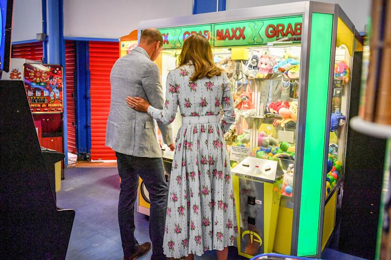 BARRY, WALES - AUGUST 05: Prince William, Duke of Cambridge and Catherine, Duchess of Cambridge play a grab a teddy game at Island Leisure Amusement Arcade, where Gavin and Stacey was filmed, during their visit to Barry Island, South Wales, to speak to local business owners about the impact of COVID-19 on the tourism sector on August 5, 2020 in Barry, Wales. (Photo by Ben Birchall - WPA Pool/Getty Images)
