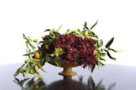 "<p>A centerpiece that incorporates both regional fruits and Christmas colors is a lovely option for those celebrating the holiday in warm climates. This arrangement focuses on one type of flower, but accents it with unexpected citrus branches. </p><p><em>Via <a href=""http://www.decorationinc.com"" rel=""nofollow noopener"" target=""_blank"" data-ylk=""slk:Decoration Inc."" class=""link rapid-noclick-resp"">Decoration Inc.</a> </em></p>"