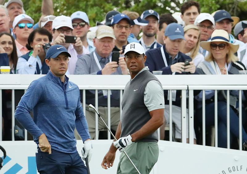McIlroy advances to face Woods in round of 16