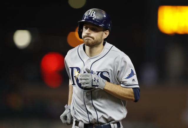 Tampa Bay Rays' Brandon Lowe heads to the dugout after flying out during the ninth inning of a baseball game against the Detroit Tigers, Tuesday, June 4, 2019, in Detroit. (AP Photo/Carlos Osorio)