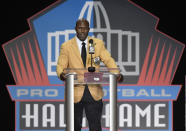 FILE - Former NFL player Terrell Davis delivers his speech during induction ceremonies at the Pro Football Hall of Fame, Saturday, Aug. 5, 2017, in Canton, Ohio. Davis is the only running back with back-to-back Super Bowl titles, an MVP trophy, a Super Bowl MVP honor, a 2,000-yard season and seven consecutive playoff wins in which he topped 100 yards rushing, a man John Elway credited with helping him finally win it all after three Super Bowl losses.(AP Photo/David Richard, File)