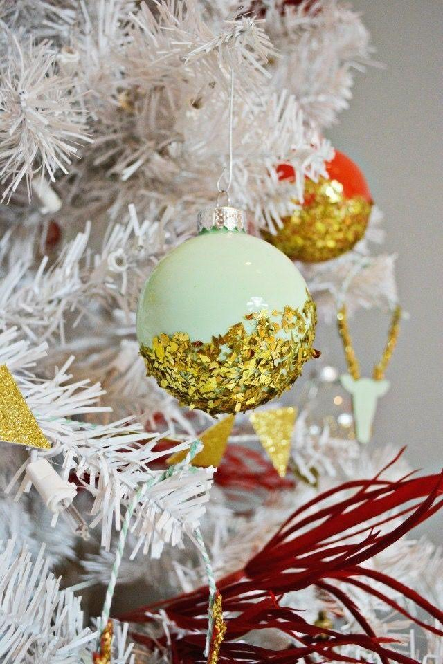 """<p>Customize the colors on this fun ornament to match your decor. Simply drop your paint of choice inside a clear ornament, then dip it in—you guessed it—glitter! </p><p><strong>Get the tutorial at <a href=""""http://www.ajoyfulriot.com/dipped-glitter-ornaments/"""" rel=""""nofollow noopener"""" target=""""_blank"""" data-ylk=""""slk:A Joyful Riot"""" class=""""link rapid-noclick-resp"""">A Joyful Riot</a>.</strong></p><p><a class=""""link rapid-noclick-resp"""" href=""""https://www.amazon.com/Apple-Barrel-Acrylic-PROMOABI-Assorted/dp/B00ATJSD8I/?tag=syn-yahoo-20&ascsubtag=%5Bartid%7C10050.g.28831556%5Bsrc%7Cyahoo-us"""" rel=""""nofollow noopener"""" target=""""_blank"""" data-ylk=""""slk:SHOP CRAFT PAINT"""">SHOP CRAFT PAINT</a></p>"""
