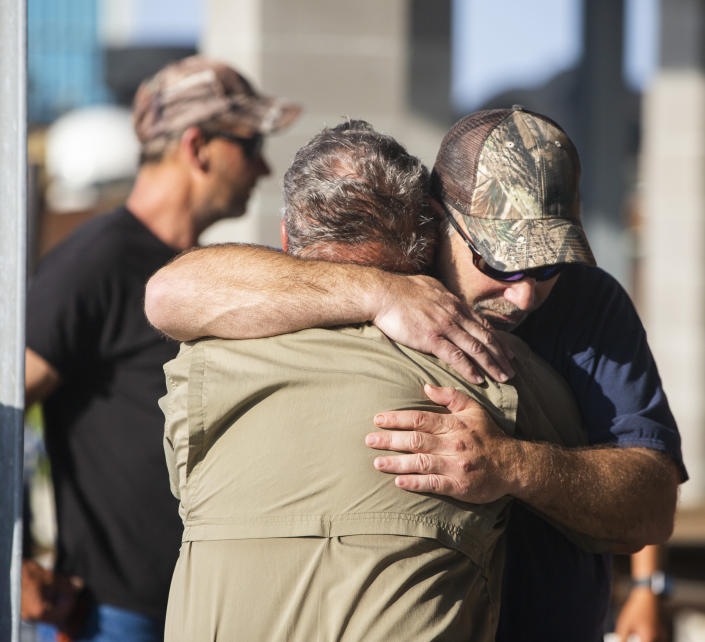 Scott Daspit, the father of missing crew member Dylan Daspit, receives a long hug of support as the search continues for 7 missing Seacor Power crew members, at Harbor Light Marina in Cocodrie, La., Thursday, April 29, 2021. The United Cajun Navy and other volunteers joined forces to locate 7 missing Seacor Power crew members 16 days after the lift boat capsized about 8 miles from Port Fourchon during bad weather. (Sophia Germer/The Advocate via AP)