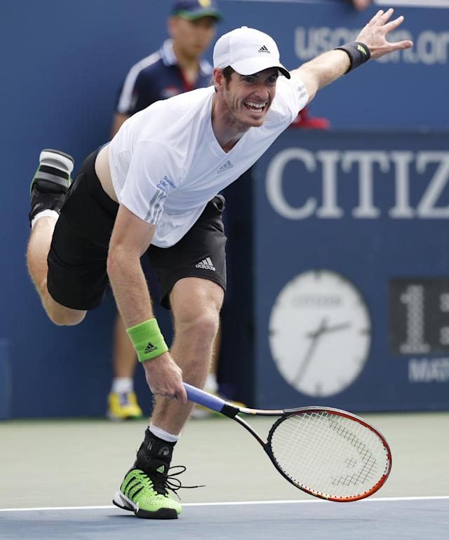 Andy Murray, of the United Kingdom serves against Andrey Kuznetsov, of Russia, during the third round of the 2014 U.S. Open tennis tournament, Saturday, Aug. 30, 2014, in New York. (AP Photo/Kathy Willens)