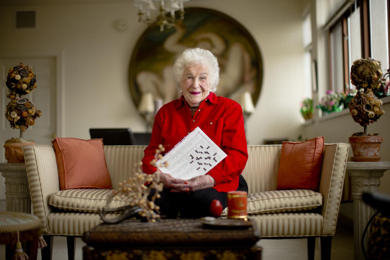Longtime crossword constructor Bernice Gordon born on Jan. 11, 1914, poses for a portrait at her home, Tuesday, Dec. 31, 2013, in Philadelphia. The New York Times is scheduled publish one of her puzzles, making her the first centenarian ever to have a grid printed in the paper. Gordon's feat comes not long after the centennial of the puzzle itself. (AP Photo/Matt Rourke)