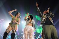 Reggaeton singers Natti Natasha, Becky G and Daddy Yankee (L to R) are seen performing at an August 2018 concert in Chicago; a new song by the two women combines sexuality and feminism, they say