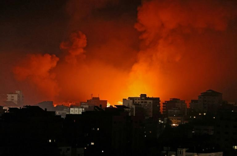 Smoke billows from a fire following Israeli airstrikes on multiple targets in Gaza City, controlled by the Palestinian Hamas movement, early on May 16