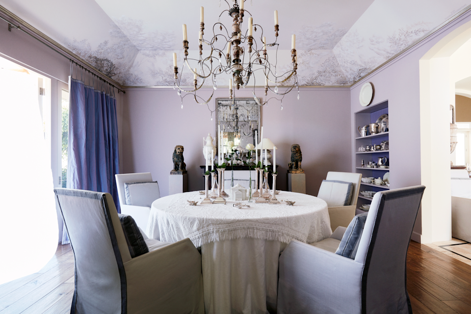 """<p>Whether you prefer a jewel-toned shade or a muted lavender, purple can be a great option for a mood-boosting wall color. <a href=""""https://www.saladinostyle.com/"""" rel=""""nofollow noopener"""" target=""""_blank"""" data-ylk=""""slk:John Saladino"""" class=""""link rapid-noclick-resp"""">John Saladino</a>'s Montecito dining room is the perfect place to unwind and enjoy a candlelit meal with loved ones at the end of the day, as it soothes and puts one at ease. It would also be precious in a child's room for inducing extra-sweet dreams. </p>"""