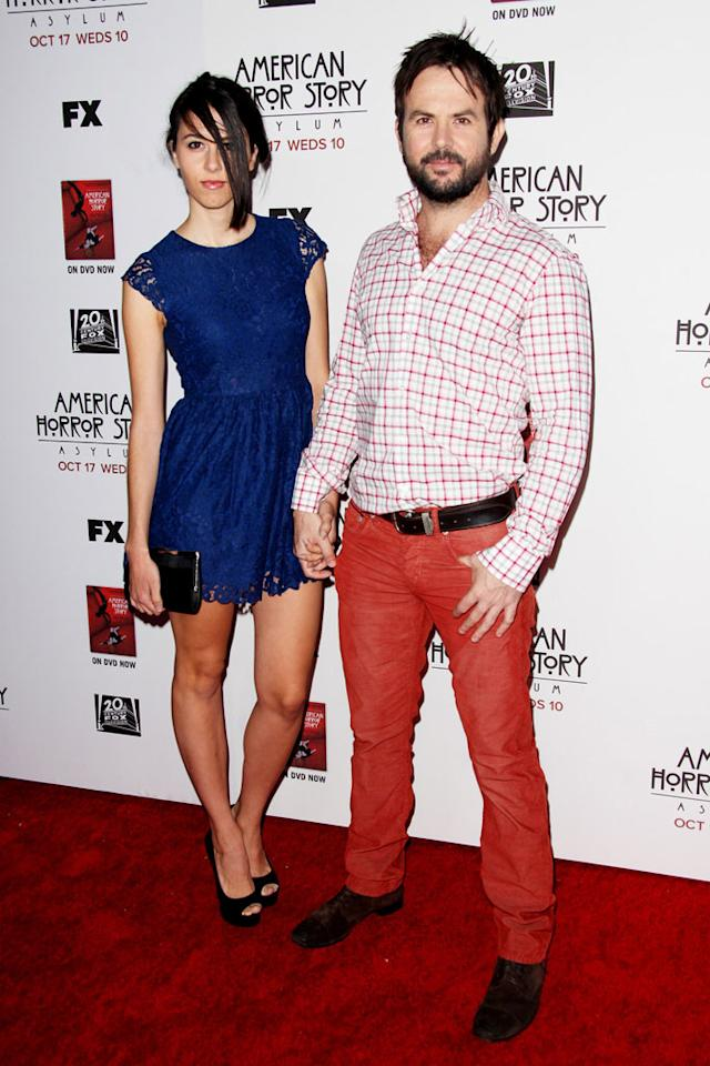 """Jason Gann and guest  attends the """"American Horror Story: Asylum"""" premiere held at Paramount Studios on October 13, 2012 in Hollywood, California."""
